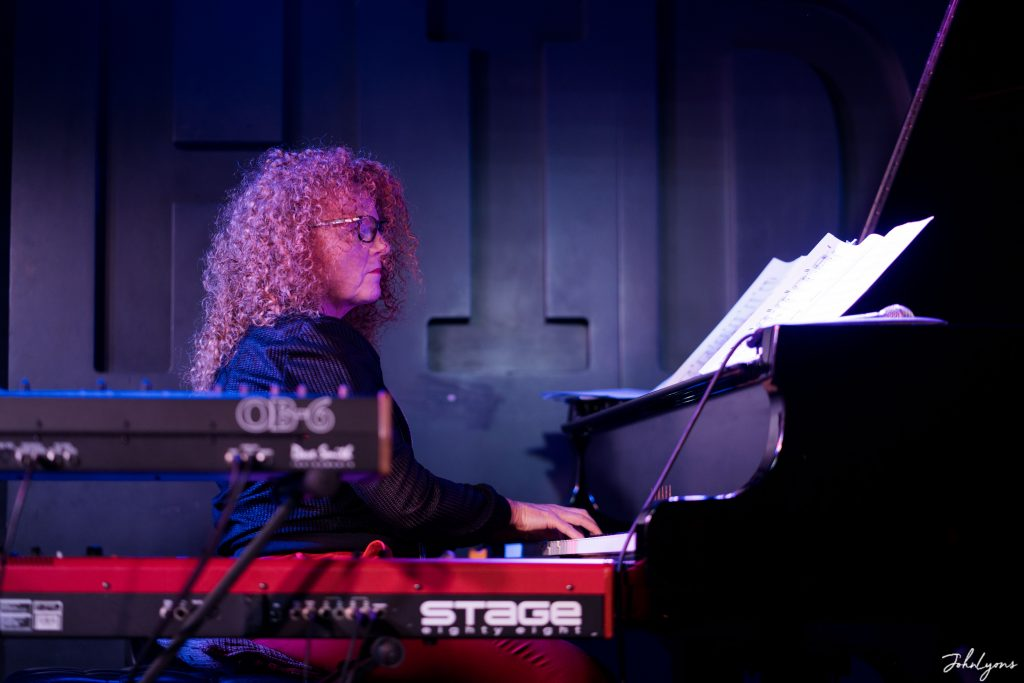 Janette Mason playing keyboards